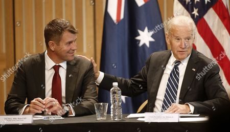 U.S. Vice President Joe Biden, right, puts his hand on the shoulder of New South Wales Premier Mike Baird as he speaks to a U.S.-Australia business round table in Sydney