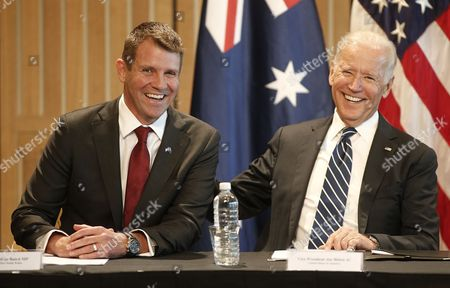 U.S. Vice President Joe Biden, right, and New South Wales state Premier Mike Baird laugh during a business roundtable in Sydney