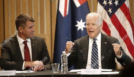 U.S. Vice President Joe Biden, right, is watched by New South Wales Premier Mike Baird as he speaks to a U.S.-Australian business round table in Sydney Monday, July 18, 2016. Biden is in Australia for four days as part of his our of the Pacific.