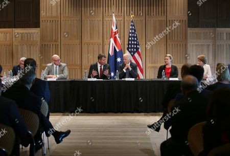 U.S. Vice President Joe Biden, center right, and New South Wales state Premier Mike Baird, center left, participate in a business roundtable at the Sydney Opera House in Sydney