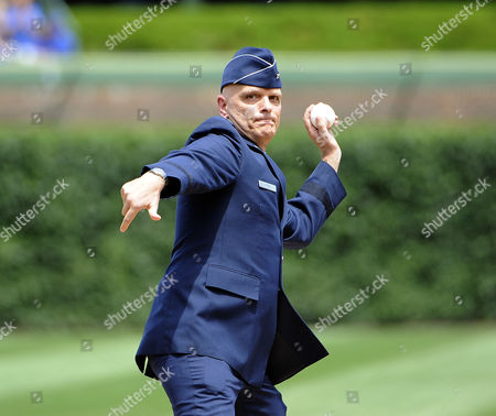 Brig. Gen. Ron Paul throws out a ceremonial first pitch before an interleague baseball game between the Chicago Cubs and the Texas Rangers