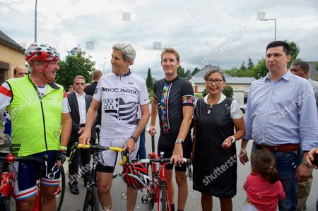 U.S. Secretary of State John Kerry, joined by Luxembourgian Foreign Minister Jean Asselborn and national biking hero Andy Schleck, outside the Restaurant Relais Bausch in Brouch