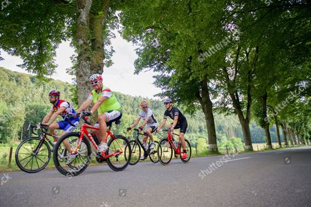 U.S. Secretary of State John Kerry, joined by Luxembourgian Foreign Minister Jean Asselborn and national biking hero Andy Schleck on a bike ride