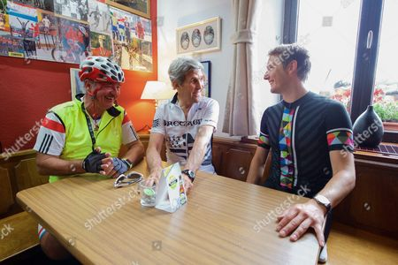 U.S. Secretary of State John Kerry, joined by Luxembourgian Foreign Minister Jean Asselborn and national biking hero Andy Schleck, sits in the Restaurant Relais Bausch in Brouch