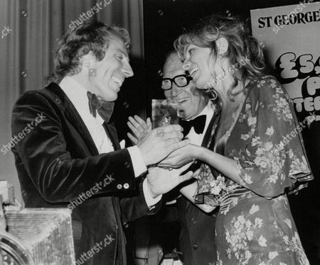 Mark Adam (l) Winner Of The Pub Entertainer Of The Year Contest At The Empire Ballroom Leicester Square With Actress Julie Ege And Comedian Arthur Askey. Box 676 40104161 A.jpg.