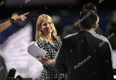 Janna Ryan, wife of House Speaker Paul Ryan of Wis. smiles as they stand at the podium during preparations at the Republican National Convention in Cleveland, Sunday, July 17, 2016.