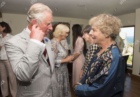 Prince Charles meets Selina Cadell who plays Mrs Tisham the pharmacist in 'Doc Martin' at Nathan Outlaw's restaurant in Port Isaac