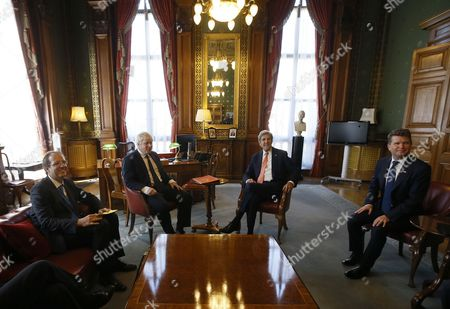 Britain's Foreign Secretary Boris Johnson, second left, and U.S. Secretary of State John Kerry, second right, with Martin Reynolds Principal Private Secretary, left, and Matthew Barzun U.S. Ambassador, right, during a meeting at the Foreign Office in London, Tuesday, July 19, 2016.