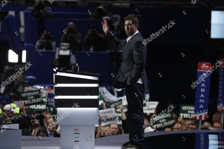 Retired U.S. Navy Seal Marcus Luttrell addresses delegates during the opening day of the Republican National Convention in Cleveland, Monday, July 18, 2016.