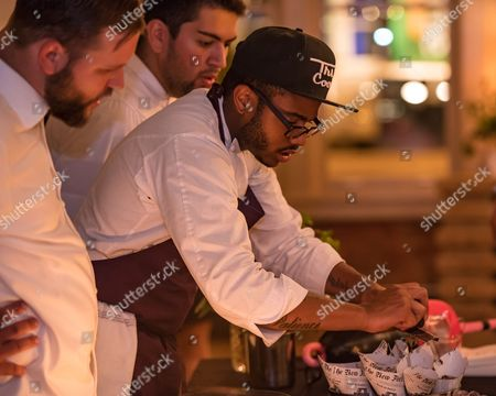 Stock Picture of Chef Kwame Onwuachi prepares Maine New Shell Lobster Pot Pie, along with The Shaw Bijou's Greg Vakinar (left) and David Paz-Grusin (right) at a chef's industry night, co-hosted with the Maine Lobster Marketing Collaborative on Monday, July 18, 2016, in Washington, D.C