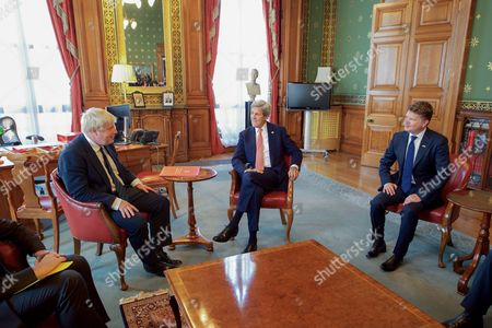 U.S. Secretary of State John Kerry and U.S. Ambassador to the United Kingdom Matthew Barzun sit with newly installed British Foreign Secretary Boris Johnson in his office in the Foreign & Commonwealth Office