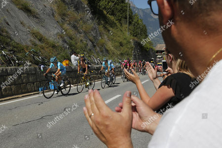 Kazakhstan's Alexey Lutsenko leads the breakaway group before France's Thomas Voeckler and Estonia's Tanel Kangert during the seventeenth stage of the Tour de France - 184.5 kilometres (114.3 miles) starting in Bern and finishing in Finhaut-Emosson, Switzerland