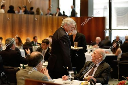 Julian Niccolini, co-owner of The Four Seasons restaurant, center, speaks with guests in the restaurant's Grill Room where the power lunch was born, in New York's landmarked Seagram building. Designed by the legendary architect Philip Johnson and the building's architect Ludwig Mies van der Rohe, the restaurant was a favorite of celebrities and business titans ever since it opened in 1959. The epitome of the midcentury style in Midtown Manhattan, The Four Seasons is scheduled to close on Saturday, July 16.