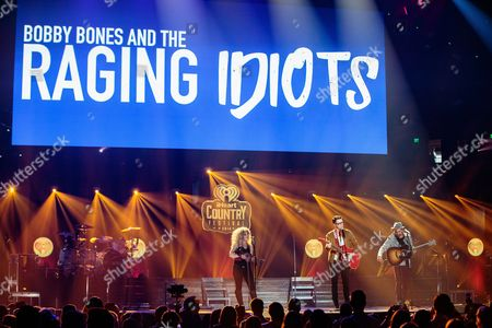 Natalie Stovall, Bobby Bones and Eddie Garcia of The Raging Idiots perform live during the event.