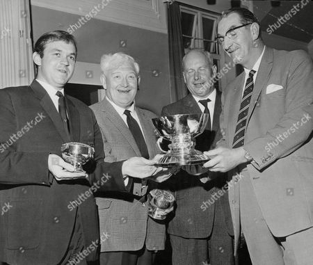 Stock Picture of Daily Mail Golf At St Annes. C. Lloyd (l) And J.c. Whitehead Receive The Trophy From Eric S. Escourt Captain Of St Annes Old Links Golf Club Watched By Daily Mail Sports Editor Bill Hicks. Box 676 401041644 A.jpg.