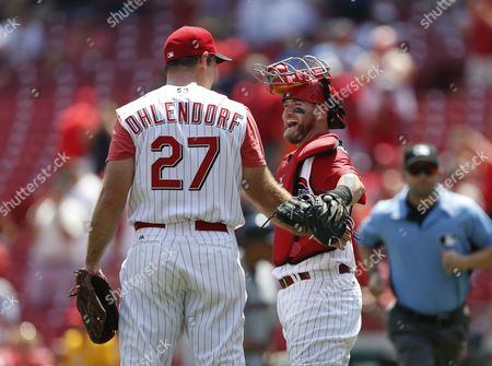Cincinnati Reds relief pitcher Ross Ohlendorf (27) and catcher Tucker Barnhart celebrate their 6-1 win over the Atlanta Braves in a baseball game