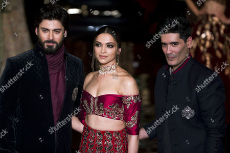 Stock Photo of Bollywood actors Deepika Padukone, and Fawad Khan, left, with India designer Manish Malhotra, right, at the India Couture Week 2016