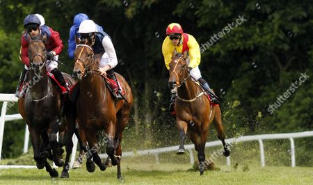Horses take a turn during The Claremont Handicap, L to R; OCTOBER STORM, ST MICHEL and OCEAN JIVE Sandown