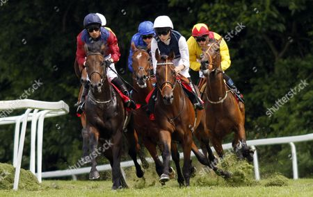 Horses take a turn during The Claremont Handicap, L to R; OCTOBER STORM, winner PARLIAMENTARIAN, ST MICHEL and OCEAN JIVE Sandown