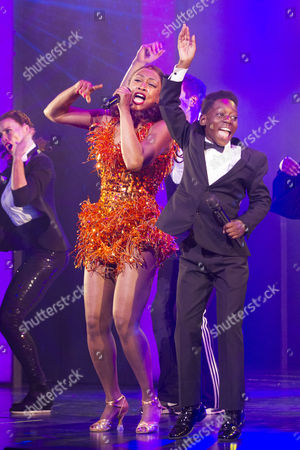 Stock Photo of Beverley Knight (Rachel Marron) and Jaden Oshenye (Fletcher) during the curtain call