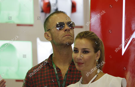Italian actor and director Rocco Siffredi, left, and his wife, Hungarian model and actress Rosa Caracciolo stand in the pit during the first practice session