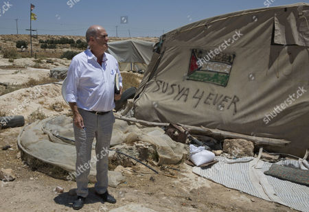 Irish author Colm Toibin, visits the West Bank village of Susiya, where some Palestinians live near ruins that were declared an archaeological site in the mid-1980s forcing them to leave, south of Hebron.