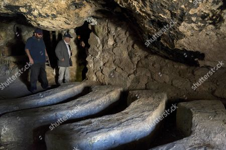 Yehuda Shaul, left, co-founder of Breaking The Silence, and Irish author Colm Toibin inspect a cave, where 34-year-old Palestinian Nasser Nawaja said he was born, during their tour of the Susiya archaeological park, adjacent to the West Bank village of Susiya, south of Hebron.