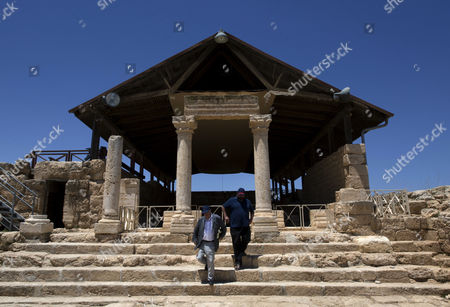 Yehuda Shaul, co-founder of Breaking The Silence, right and Irish author Colm Toibin, inspect the location of a synagogue, during a tour of the Susiya archaeological park, adjacent to the West Bank village of Susiya, south of Hebron.