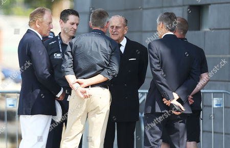 Stock Picture of The Duke of Edinburgh Prince Philip speaks with Land Rover BAR CEO Martin Whitmarsh after watching the racing during Day One of the Louis Vuitton America's Cup World Series Portsmouth, Hampshire on July 22nd 2016