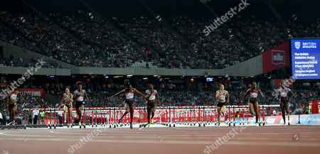 USA's Kendra Harrison (centre) wins the Women's 100m hurdles final and breaks the World Record during Day 1 of the Muller Anniversary Games at The Stadium, Queen Elizabeth Olympic Park, London on July 22nd 2016