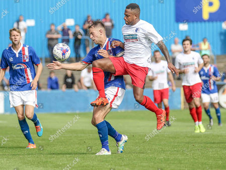 Couglin O'Connor challenges Danny Grainger during the Pre-Season Friendly match between Barrow and Carlisle United at Holker Street, Barrow