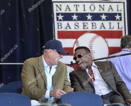 Hall of Famers Goose Gossage, left, and Rickey Henderson laugh during an awards ceremony at Doubleday Field on, in Cooperstown, N.Y