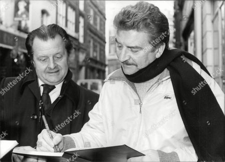 Stock Picture of Actor Peter Adamson (right) Signing An Autograph. Box 679 3220041610 A.jpg.