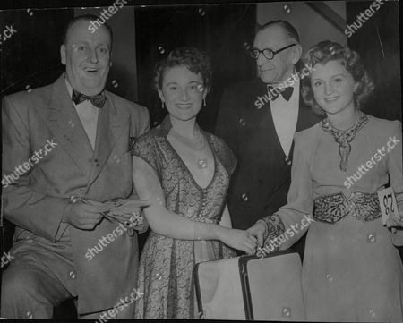 Actress Avril Angers Commentator Barrington Dalby (glasses) And Comedian Billy Howard Congratulate Maria Alfieri Winner Of The 1952 Miss Wimpey Beauty Contest. Box 680 326041643 A.jpg.