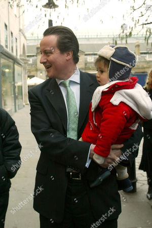 David Cameron holding Sonny, the son of the Big Issue founder John Bird
