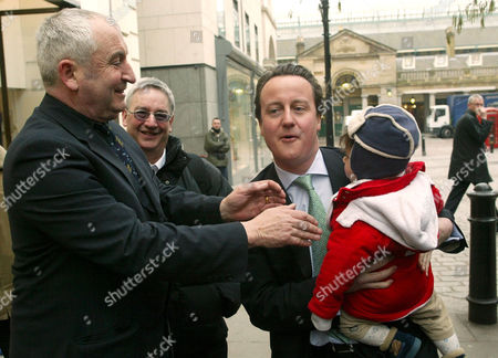 David Cameron with the Big Issue founder John Bird and his son Sonny