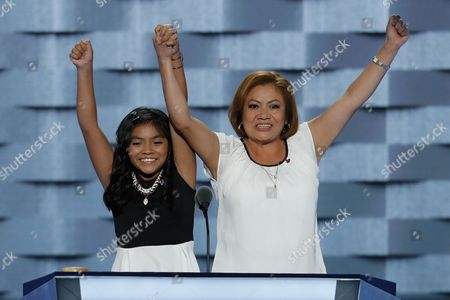 11-year-old Karla Ortiz, left, and her mother Francisca Ortiz speak during the first day of the Democratic National Convention in Philadelphia , . AP Photo/J. Scott Applewhite
