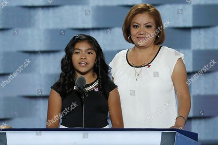 11-year-old Karla Ortiz, left, of Las Vegas, speaks during the first day of the Democratic National Convention in Philadelphia ,  and her mother Francisca Ortiz listens. AP Photo/J. Scott Applewhite