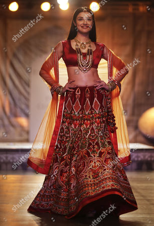 Bollywood actress Divya Khosla Kumar displays a creation by designer Reynu Taandon at the India Couture Week 2016 in in New Delhi, India