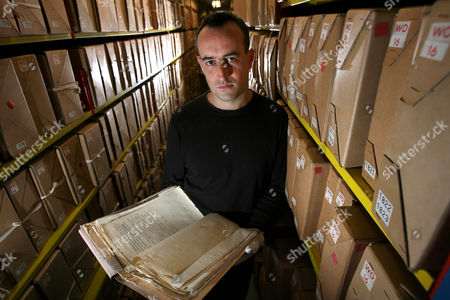Historian Nick Barratt looking through a file on his relative Ernest Holloway Oldham