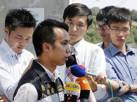 Kenneth Tong of the Hong Kong Immigration Center, 2nd left, talks to media people about the status of Hong Kong Citizen who were injured in an attack in front of the university hospital