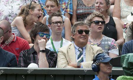 Stephen Fry Watches The Tennis With His Partner Elliott Spencer. Day 8: Maria Sharapova V Coco Vandeweghe Wimbledon 2015 Tennis Championships Wimbledon London.