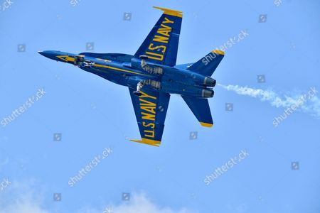 U.S. Navy flight demonstration squadron, the Blue Angels, lead solo pilot Lt. Ryan Chamberlain performs a Dirty Roll on Takeoff during a practice for the Sioux Falls Airshow, Power on the Prairie