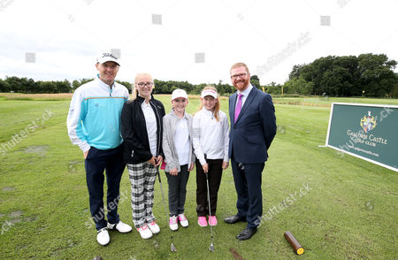 NI Open Tournament Ambassador Michael Hoey pictured along with Economy Minister Simon Hamilton as Galgorm Castle's Fun Golf Area officially opens along with junior golfers