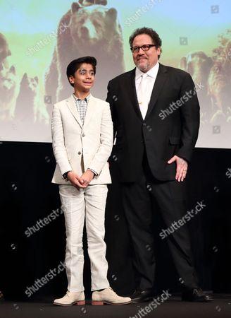 Neel Sethi and Jon Favreau