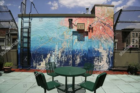 Stock Picture of A mural painted by artist Jose Parla decorates a wall and entrance to a courtyard on top of the Incarnation Children's Center in New York. The mural is one of many commissioned by RxArt to make pediatrics facilities less intimidating with site-specific installations in the belief visual arts have the power to help children heal
