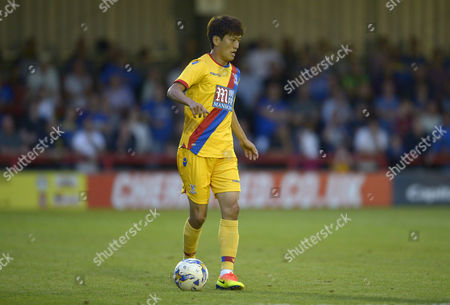 Chung-Yong Lee of Crystal Palace in action during the pre-season friendly match between AFC Wimbledon and Crystal Palace played at The Cherry Red Records Stadium, Kingston Surrey on July 27th, 2016