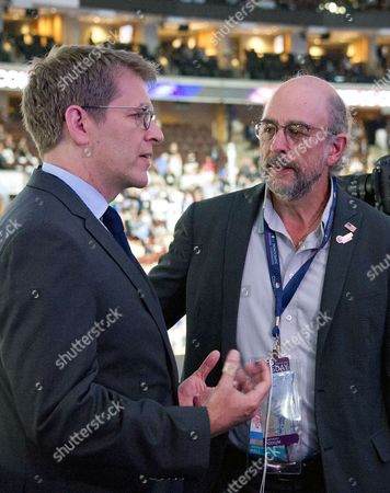 Stock Picture of Former White House Press Secretary Jay Carney and actor Richard Schiff have a conversation over the podium at the 2016 Democratic National Convention held at the Wells Fargo Center in Philadelphia, Pennsylvania.