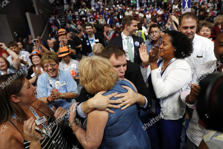 Stock Picture of Virginia delegate Morgan Jameson hugs Virginia Democratic Party Chair Susan Swecker as Democratic vice presidential candidate, Sen. Tim Kaine, D-Va., officially become the vice presidential nominee during the third day session of the Democratic National Convention in Philadelphia