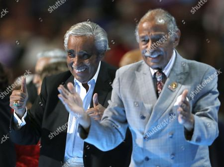 Stock Picture of Rep. Charlie Rangel, D-NY, left, gives a thumbs up alongside Rep. John Conyers, D-Mich., as they take the stage during the third day of the Democratic National Convention in Philadelphia